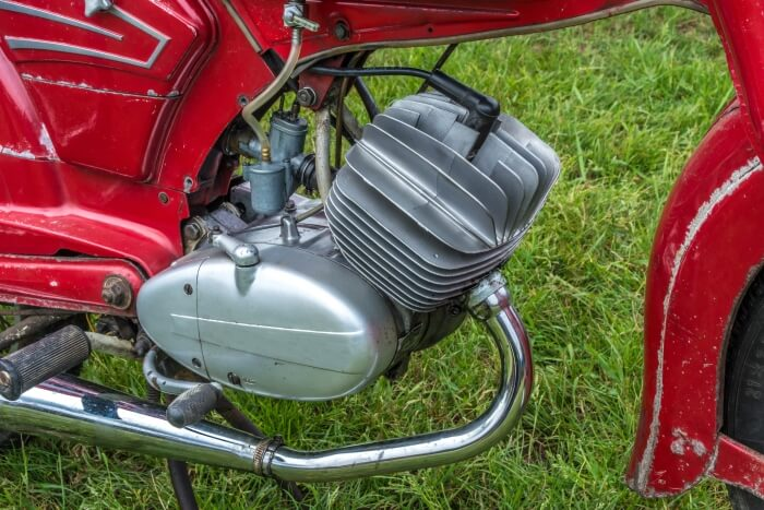 Classic two-stroke engine on a moped with mixture lubrication