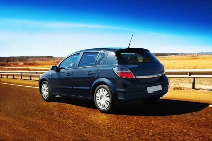 Opel Corsa on the road in the desert